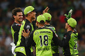 Clint McKay of the Thunder celebrates with his team after taking the wicket of Chris Gayle of the Renegadesduring the Big Bash League match between...