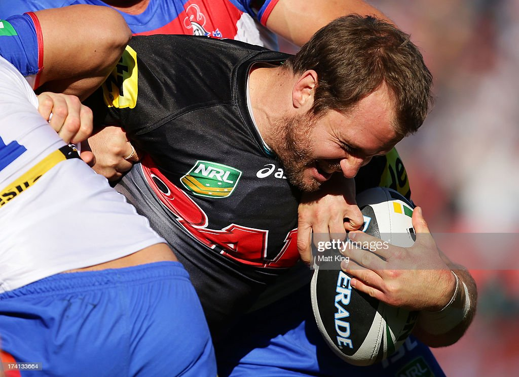 Clint Newton of the Panthers is tackled during the round 19 NRL match between the Penrtih Panthers and the Newcastle Knights at Centrebet Stadium on July 21, 2013 in Penrith, Australia.