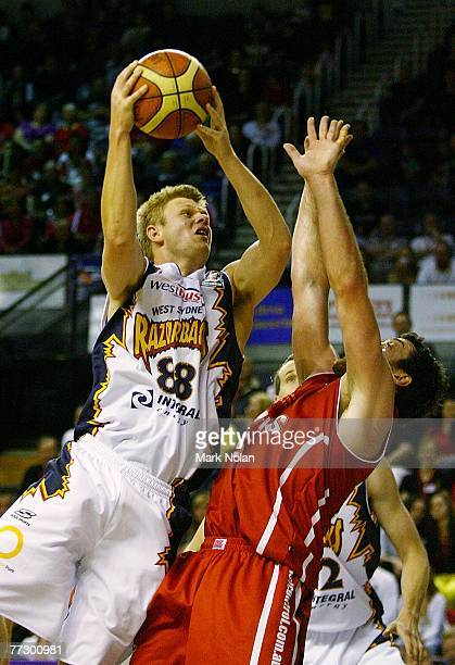 Clint Reed of the Razorbacks drives to the basket during the round four NBL match between the Wollongong Hawks and the West Sydney Razorbacks at the...