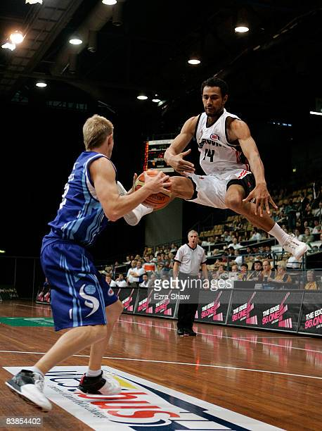 Clint Reed of the Spirit steals the ball from Mika Vukona of the Dragons during the round 11 NBL match between the Sydney Spirit and the South...