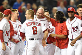Clint Robinson of the Washington Nationals celebrates with team mates a walk off home run during a baseball game against the Detroit Tigers at...
