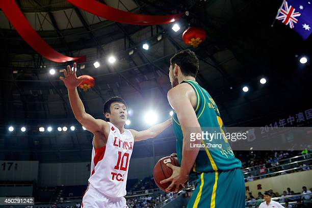 Clint Steindl of Australia looks to pass against Ding Yanyuhang of China during the 2014 SinoAustralia Men's International Basketball Challenge match...