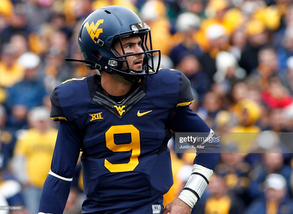 Clint Trickett of the West Virginia Mountaineers looks on against the Baylor Bears during the game on October 18 2014 at Mountaineer Field in...