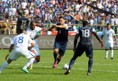 US Clinton Dempsey and Honduras Victor Bernardez vie for the ball during their Brazil2014 FIFA World Cup CONCACAF football qualifier at Olimpico...