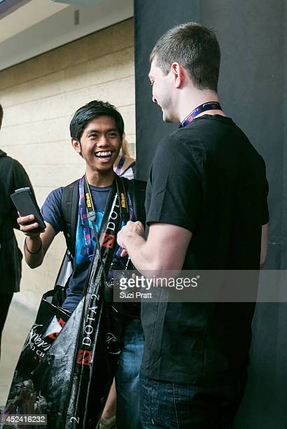 Clinton 'Fear' Loomis of Evil Geniuses talks with an excited fan at The International DOTA 2 Champsionships at Key Arena on July 19 2014 in Seattle...