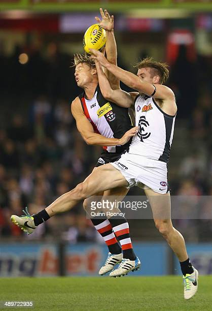 Clinton Jones of the Saints attempts to spoil a mark by Sam Docherty of the Blues during the round eight AFL match between the St Kilda Saints and...