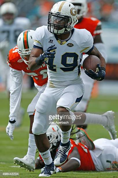 Clinton Lynch $49 of the Georgia Tech Yellow Jackets runs with the ball against the Miami Hurricanes on November 21 2015 at Sun Life Stadium in Miami...