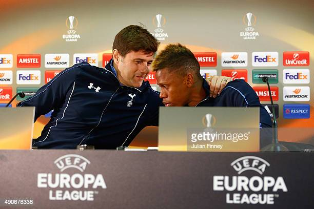Clinton Njie of Spurs and Mauricio Pochettino coach of Spurs talk during Tottenham Hotspur FC training and press conference at Stade Louis II on...
