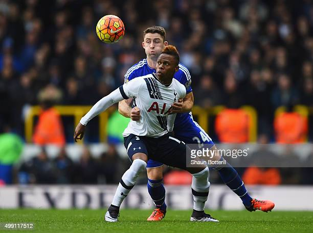 Clinton N'Jie of Tottenham Hotspur holds off Gary Cahill of Chelsea during the Barclays Premier League match between Tottenham Hotspur and Chelsea at...
