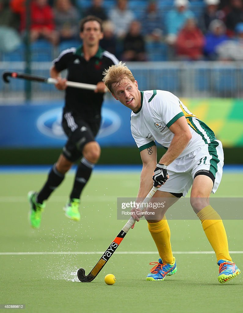Clinton Panther of South Africa looks to pass the ball during the men's preliminaries match between Wales and South Africa at the Glasgow National Hockey Centre during day six of the Glasgow 2014 Commonwealth Games on July 29, 2014 in Glasgow, United Kingdom.