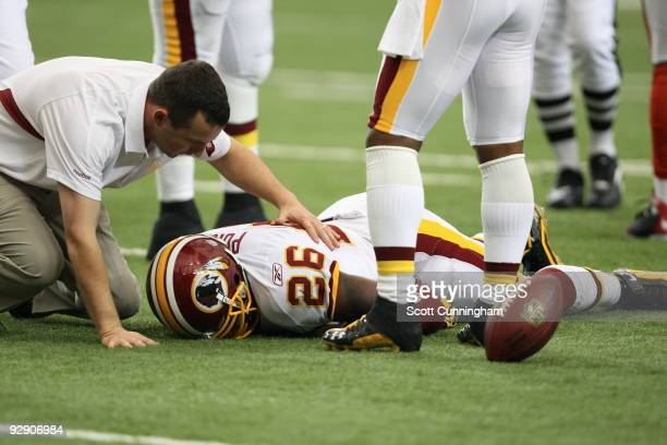 Clinton Portis of the Washington Redskins suffers a concussion on a play against the Atlanta Falcons at the Georgia Dome on November 8 2009 in...