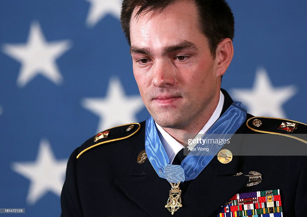 Clinton Romesha (L), a former active duty Army Staff Sergeant, stands after he was presented with the Medal of Honor for conspicuous gallantry by U.S. President Barack Obama at the White House February 11, 2013 in Washington, DC. Romesha received the Medal of Honor for actions during combat operations against an armed enemy at Combat Outpost Keating, Kamdesh District, Nuristan Province, Afghanistan on October 3, 2009.