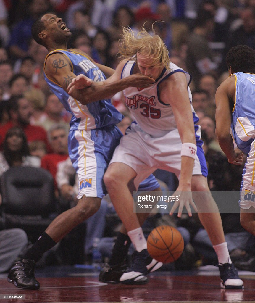 Clipper center Chris Kaman right s a hand in his mouth but