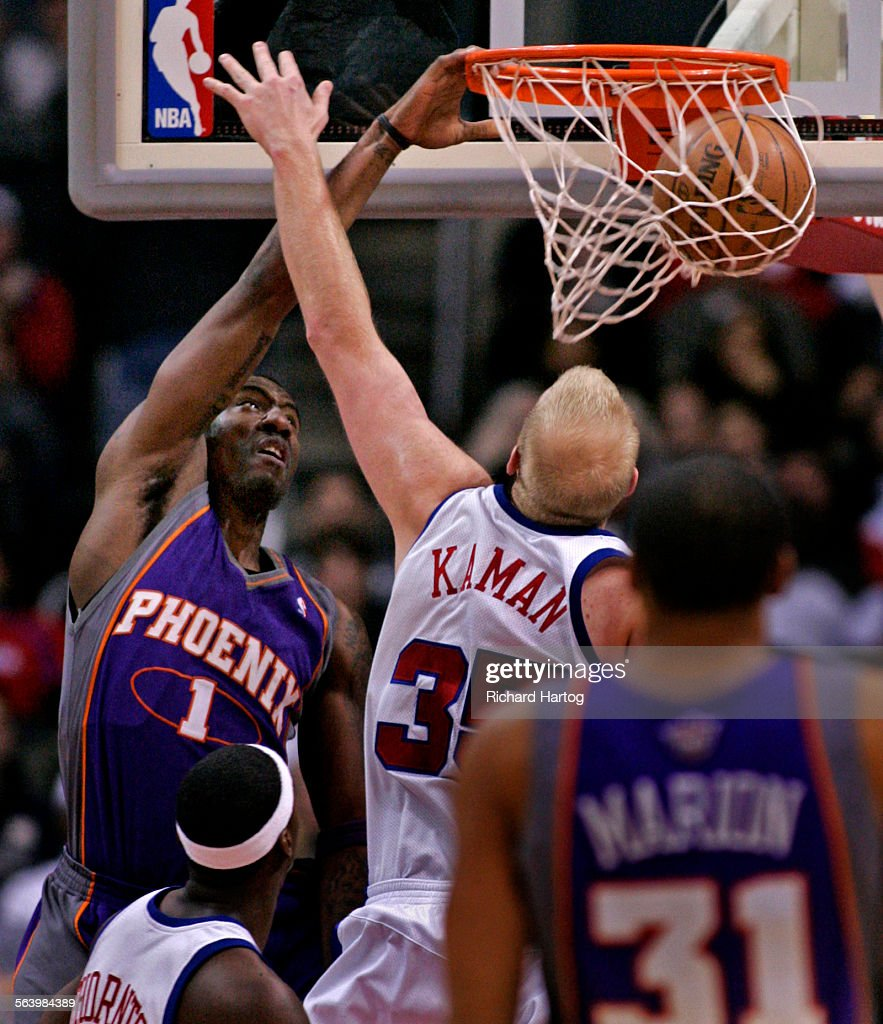 Clipper Chris Kaman right tries to defend but he can t stop