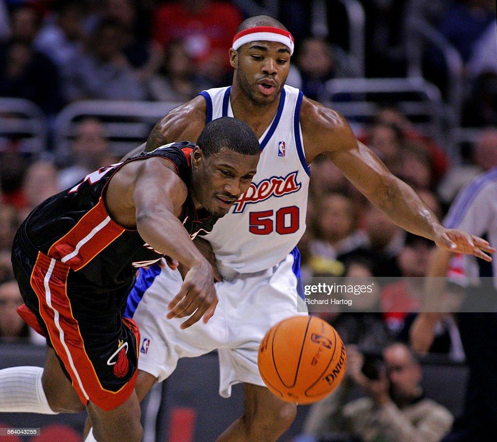 Clipper Clipper Corey Mag te looks on as Miami Heat s James