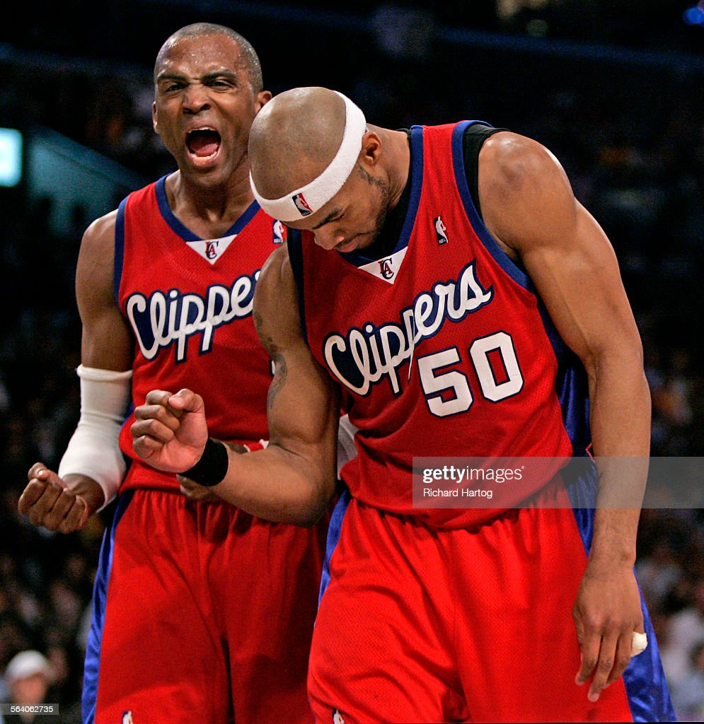 Clipper Cuttino Mobley left lets out a roar as teammate Corey