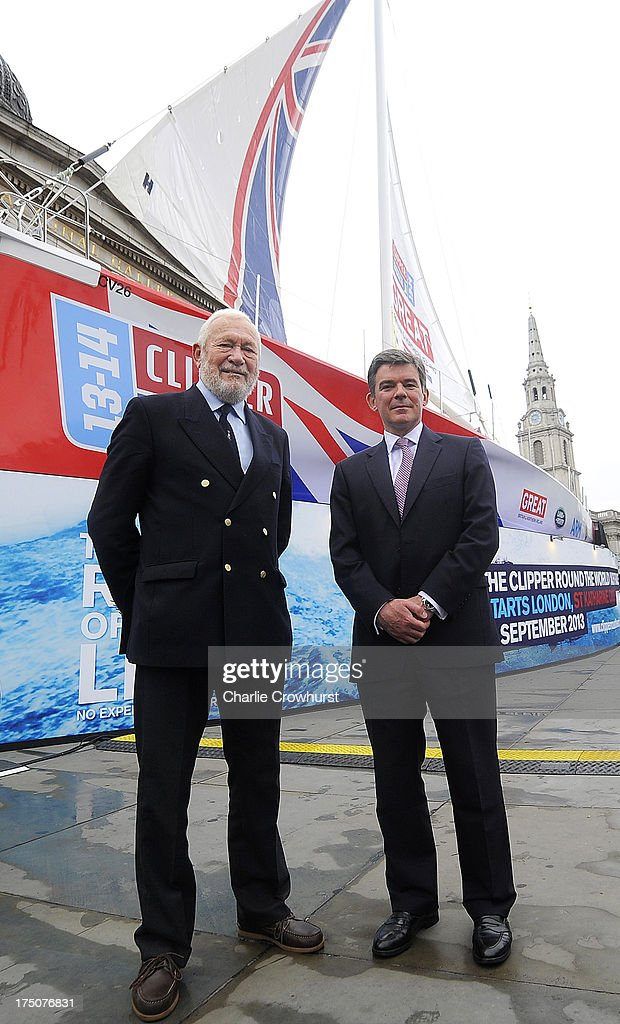 Clipper Race Chairman and Founder Robin Knox-Johnston and Sports Minister Hugh Robertson pose for a photo infront of The Great Britain Yacht during the Clipper Round the World Yacht Race Press Conference at Trafalgar Square on July 31, 2013 in London, England.