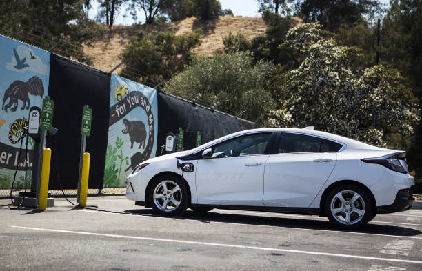 Electric vehicle charging stations as city council signs for General motors vehicle purchase program