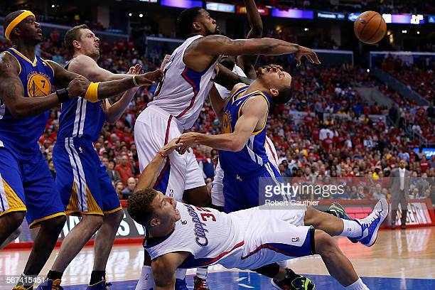LOS ANGELES CA SATURDAY APRIL 19 2014 Clippers center DeAndre Jordan shoves Warriors guard Stephen Curry in the face as Blake Griffin falls as Golden...