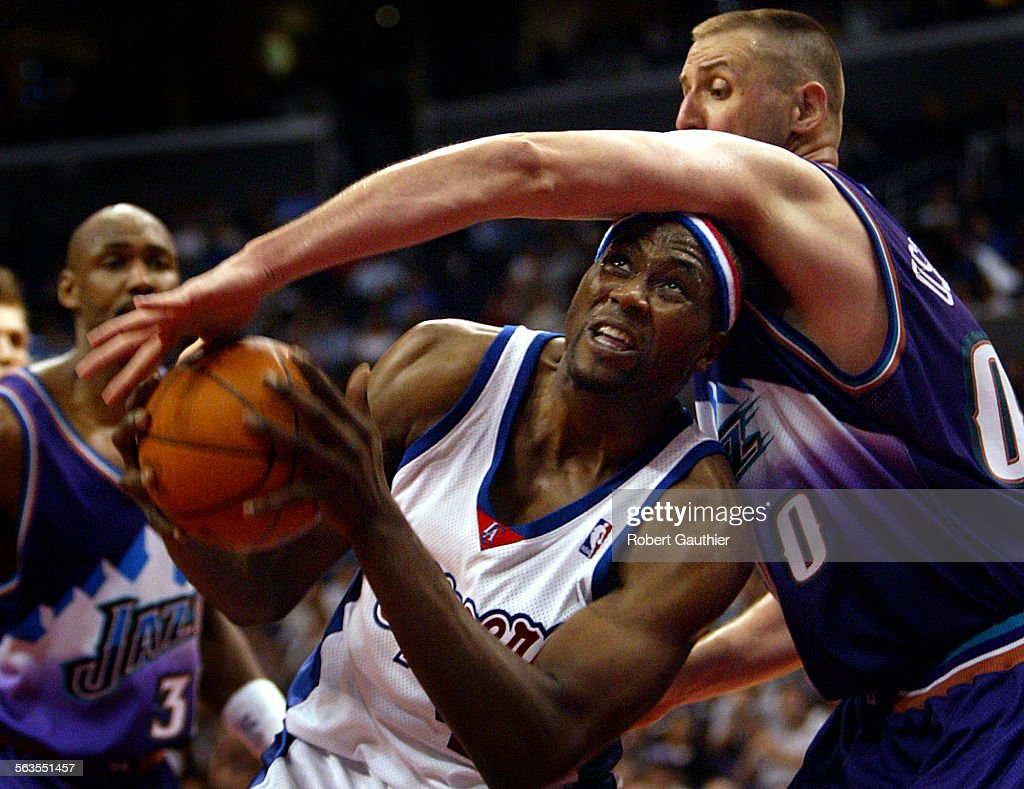 Clippers center Elton Brand is fouled by Utah Jazz center Greg