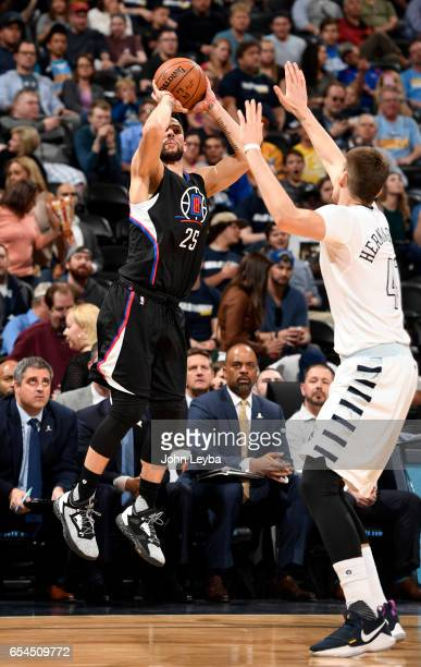 Clippers guard Austin Rivers takes a shot over Denver Nuggets forward Juancho Hernangomez during their game on March 16 2017 in Denver Colorado at...