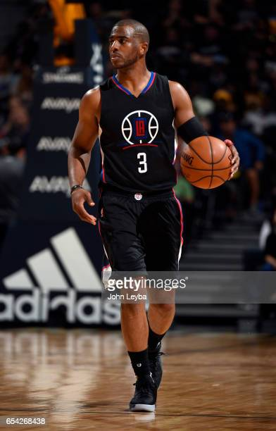 Clippers guard Chris Paul brings the ball up court during the third quarter against the Denver Nuggets on March 16 2017 in Denver Colorado at Pepsi...