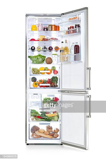 clipping path on isolated fridge full of fresh food