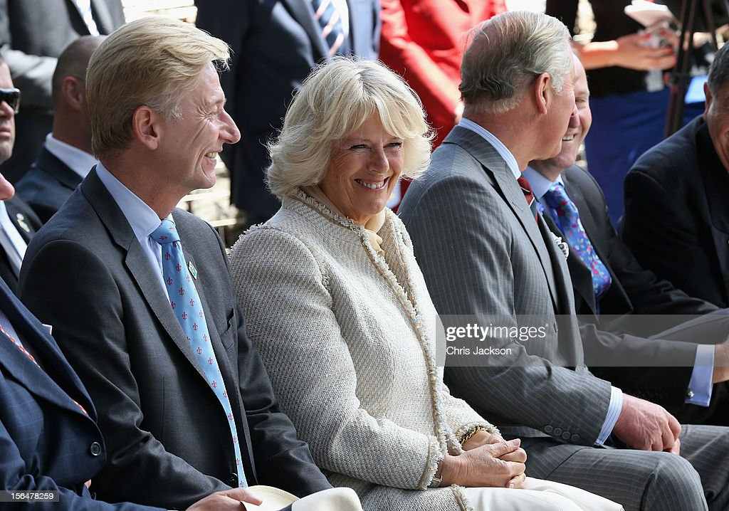 Clive Alderton, <a gi-track='captionPersonalityLinkClicked' href=/galleries/search?phrase=Camilla+-+Duchess+of+Cornwall&family=editorial&specificpeople=158157 ng-click='$event.stopPropagation()'>Camilla</a>, Duchess of Cornwall and <a gi-track='captionPersonalityLinkClicked' href=/galleries/search?phrase=Prince+Charles+-+Prince+of+Wales&family=editorial&specificpeople=160180 ng-click='$event.stopPropagation()'>Prince Charles</a>, Prince of Wales share a joke during a visit to Christchurch on November 16, 2012 in Christchurch, New Zealand. The Dance-O-Mat was set up to give people the opportunity to keep dancing after many of the venues were destroyed by the earthquake of 2010. The Royal couple are in New Zealand on the last leg of a Diamond Jubilee that takes in Papua New Guinea, Australia and New Zealand.
