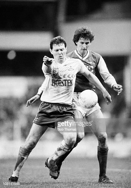 Clive Allen of Tottenham Hotspur is challenged by Tony Adams of Arsenal during the Littlewoods Cup Semifinal 2nd leg match held at White Hart Lane...