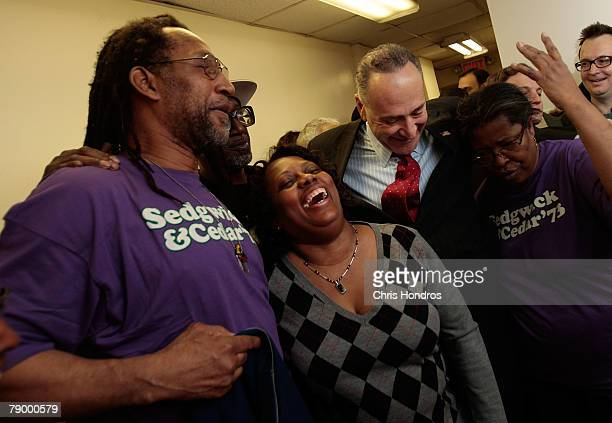 Clive Campbell also known as DJ Kool Herc resident Gloria Robinson Sen Charles Schumer and another woman laugh after a press conference about the...