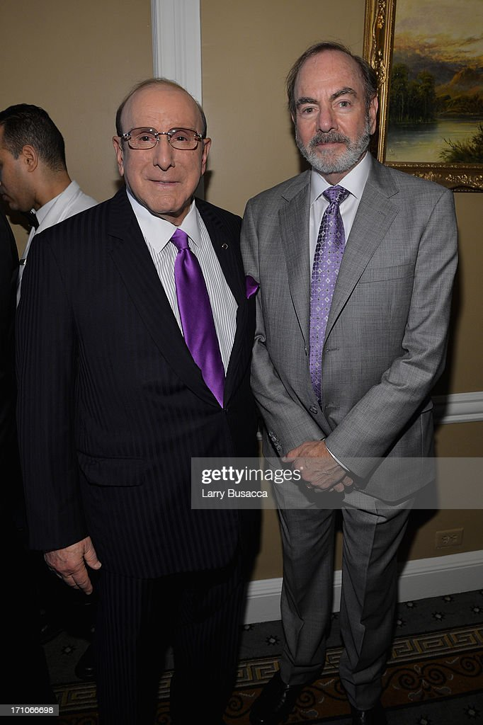 Clive Davis and Neil Diamond attend a luncheon honoring Rob Stringer as UJA-Federation of New York Music Visionary of 2013 at The Pierre Hotel on June 21, 2013 in New York City.