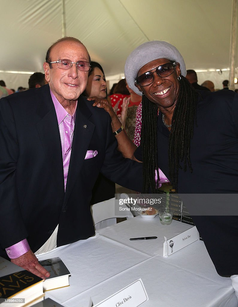 <a gi-track='captionPersonalityLinkClicked' href=/galleries/search?phrase=Clive+Davis&family=editorial&specificpeople=209314 ng-click='$event.stopPropagation()'>Clive Davis</a> and <a gi-track='captionPersonalityLinkClicked' href=/galleries/search?phrase=Nile+Rodgers&family=editorial&specificpeople=217582 ng-click='$event.stopPropagation()'>Nile Rodgers</a> attend the East Hampton Library's Authors Night 2013 at Gardiner's Farm on August 10, 2013 in East Hampton, New York.
