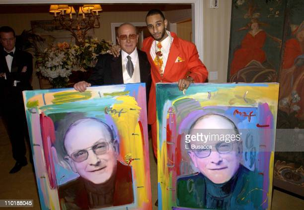 Clive Davis and Swizz Beatz during 2004 Clive Davis PreGrammy Party Inside Arrivals at Beverly Hills Hotel in Beverly Hills California United States