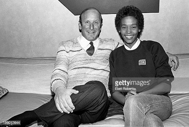 Clive Davis and Whitney Houston photographed at the signing of her contract with Arista Records at the Arista Studio in New York on April 10 1983