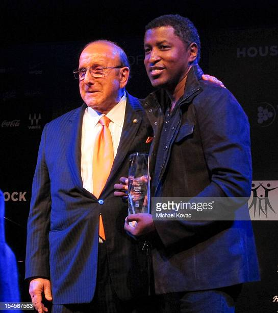 Clive Davis poses with Kenneth 'Babyface' Edmonds recipient of the Clive Davis Legend in Songwriting Award at City Of Hope's Songs Of Hope VIII at...