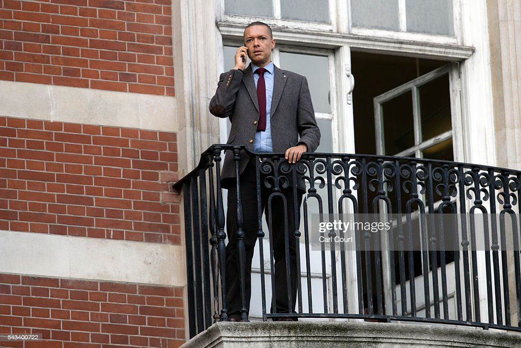 Clive Lewis, the newly-promoted Shadow Secretary of State for Defence, uses his mobile phone on the balcony of Jeremy Corbyn's office as Mr Corbyn holds a meeting inside on June 28, 2016 in London, England. Mr Corbyn is facing increased calls to resign as leader and a vote of no confidence later today is expected to see up to 150 MPs vote against him.