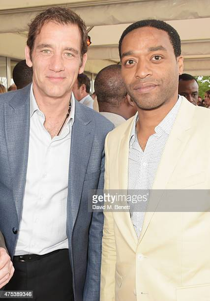 Clive Owen and Chiwetel Ejiofor attend day two of the Audi Polo Challenge at Coworth Park on May 31 2015 in London England
