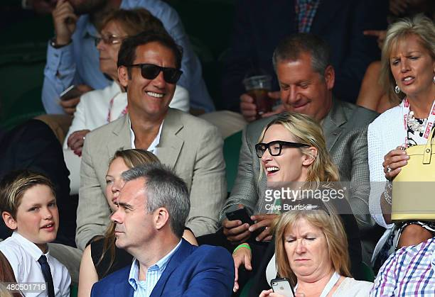 Clive Owen and Kate Winslet attend day thirteen of the Wimbledon Lawn Tennis Championships at the All England Lawn Tennis and Croquet Club on July 12...