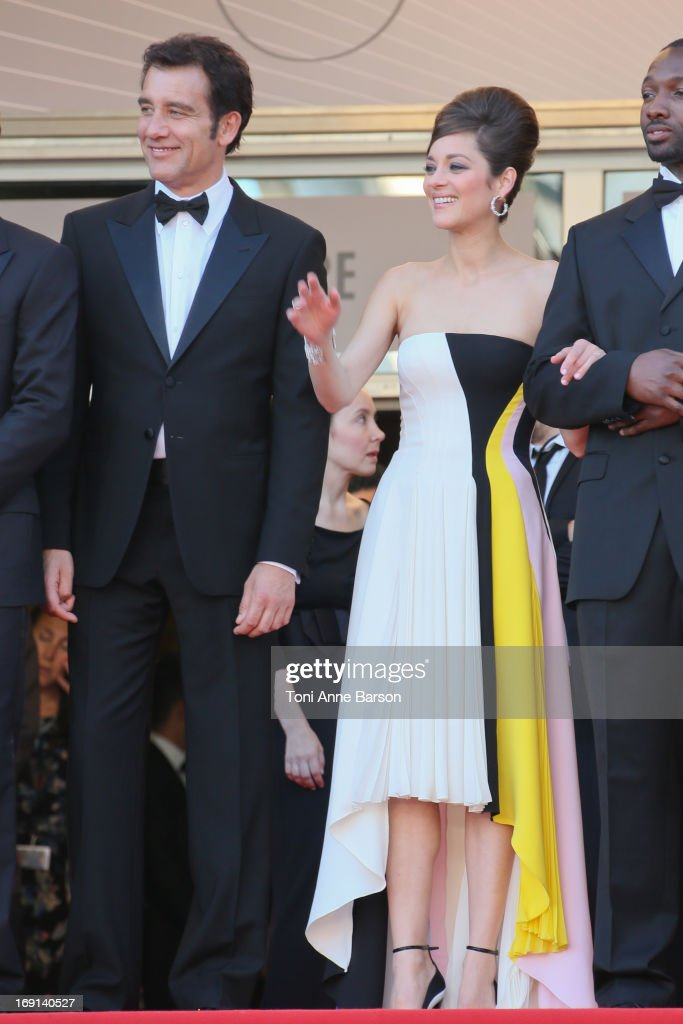 Clive Owen and Marion Cotillard attend the Premiere of 'Blood Ties' during the 66th Annual Cannes Film Festival at the Palais des Festivals on May 20, 2013 in Cannes, France.