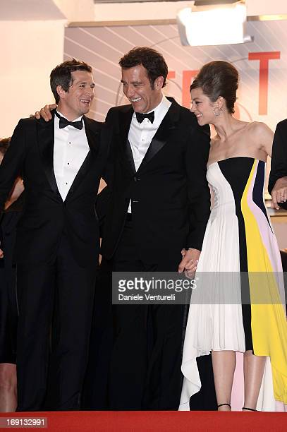 Clive Owen director Guillaume Canet and actress Marion Cotillard leave the Premiere of 'Blood Ties' during the 66th Annual Cannes Film Festival at...