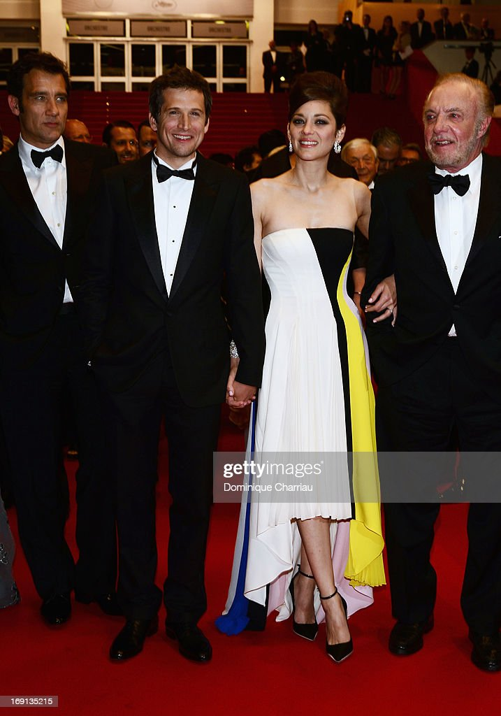 Clive Owen, director Guillaume Canet and actress Marion Cotillard leave the Premiere of 'Blood Ties' during the 66th Annual Cannes Film Festival at the Palais des Festivals on May 20, 2013 in Cannes, France.