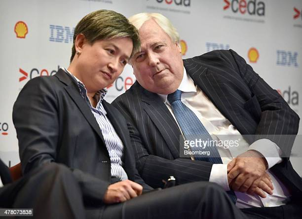 Clive Palmer federal leader of the Palmer United Party and chairman of Mineralogy Pty right speaks to Penny Wong Senate leader of Australia's...