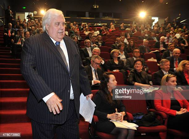 Clive Palmer federal leader of the Palmer United Party and chairman of Mineralogy Pty left approaches the stage during the State of the Nation...