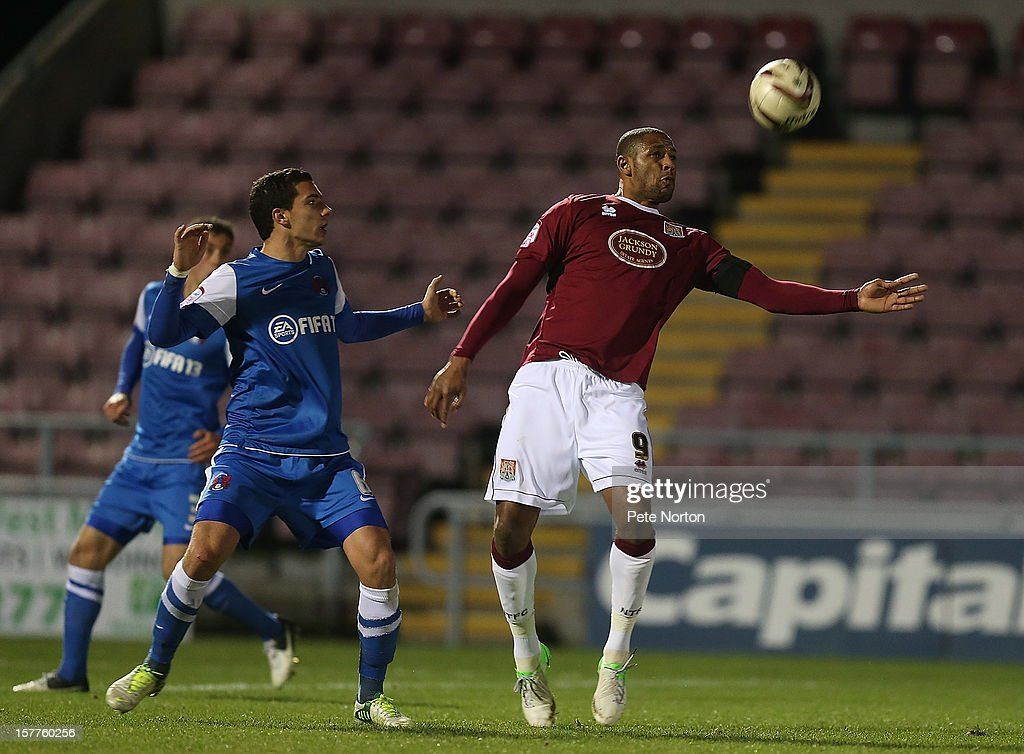 Clive Platt of Northampton Town attempts to control the ball watched by Matthieu Baudry of Leyton Orient during the Johnstone's Paint Trophy Quarter Final match between Northampton Town and Leyton Orient at Sixfields Stadium on December 5, 2012 in Northampton, England.