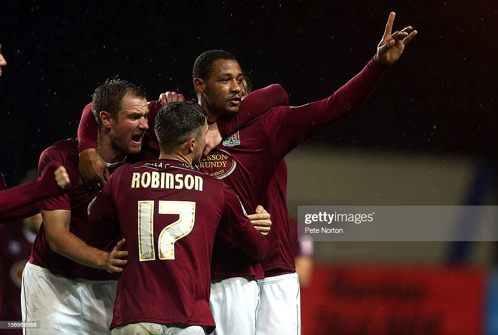 Clive Platt of Northampton Town celebrates with team mates after scoring his sides goal during the npower League Two match between Oxford United and Northampton Town at Kassam Stadium on November 24, 2012 in Oxford, England.