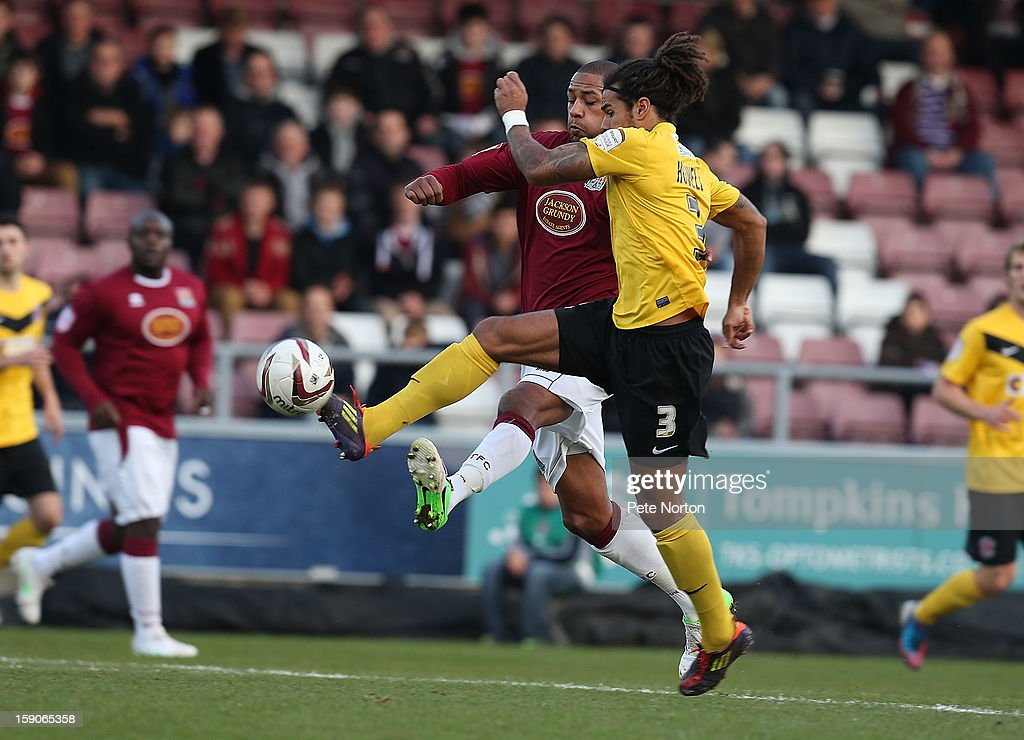 Clive Platt of Northampton Town challenges for the ball with Dean Howells of Fleetwood Town during the npower League Two match between Northampton Town and Fleetwood Town at Sixfields Stadium on January 5, 2013 in Northampton, England.