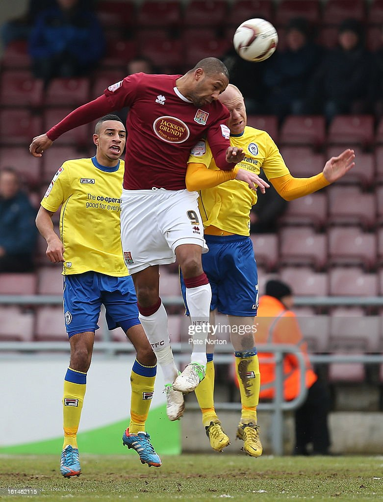 Clive Platt of Northampton Town challenges for the ball with Jason Kennedy of Rochdale during the npower League Two match between Northampton Town and Rochdale at Sixfields Stadium on February 9, 2013 in Northampton, England.