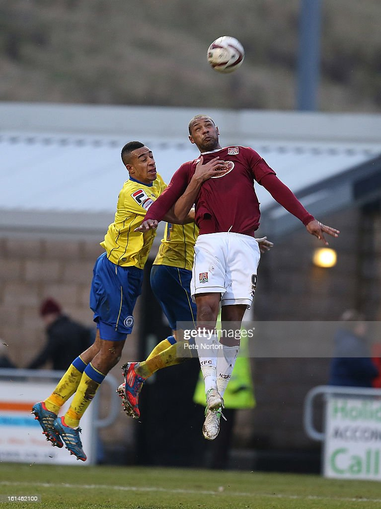 Clive Platt of Northampton Town challenges for the ball with Rhys Bennett of Rochdale during the npower League Two match between Northampton Town and Rochdale at Sixfields Stadium on February 9, 2013 in Northampton, England.