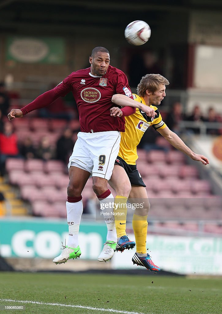 Clive Platt of Northampton Town challenges for the ball with Rob Atkinson of Fleetwood Town during the npower League Two match between Northampton Town and Fleetwood Town at Sixfields Stadium on January 5, 2013 in Northampton, England.