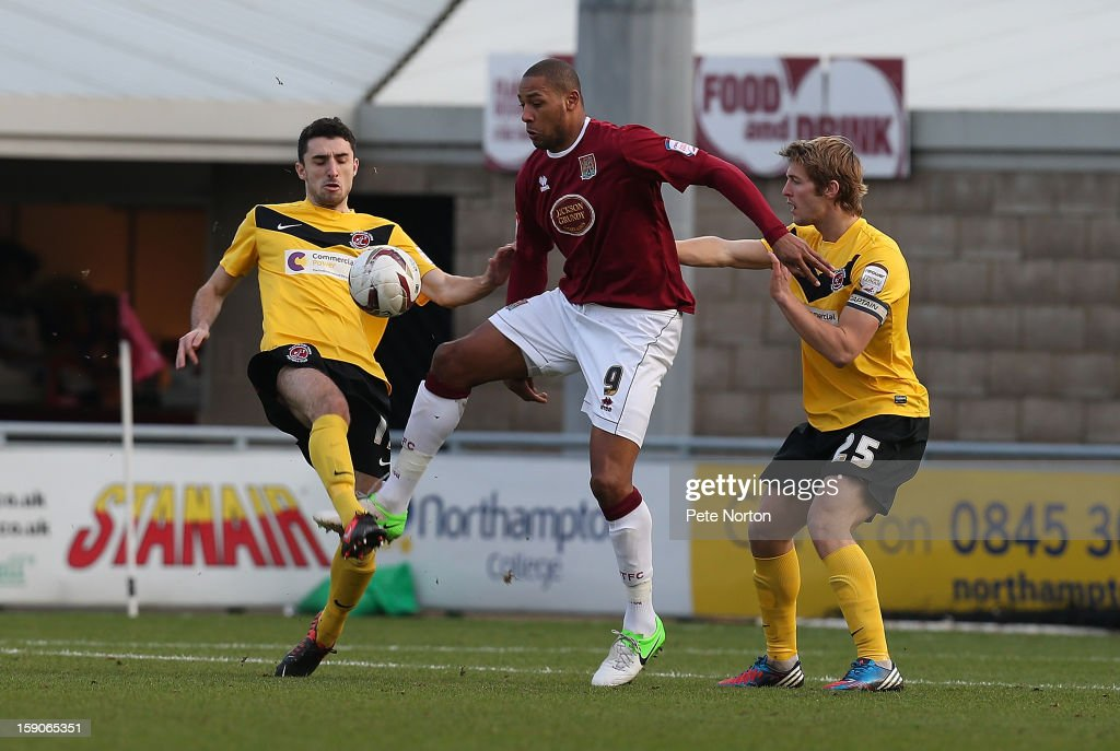 Clive Platt of Northampton Town looks to control the ball under pressure from Rob Atkinson #25 and Conor McLaughlin of Fleetwood Town during the npower League Two match between Northampton Town and Fleetwood Town at Sixfields Stadium on January 5, 2013 in Northampton, England.